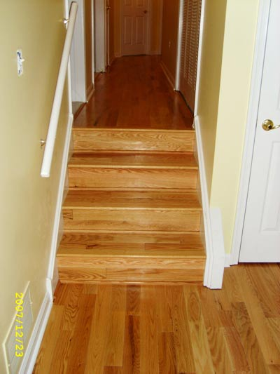 A closer look at the hardwood stairs that lead to the second level