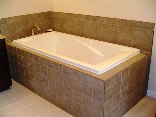 Full tile surround tub deck
