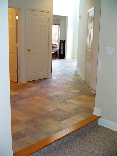 Natural stained oak stair nose with ceramic tile pattern work