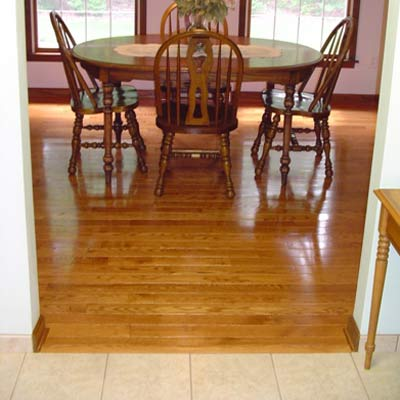 Kitchen Ceramic Tile With Base Trim Even Grade Transitioned Into Hardwood Dining Room