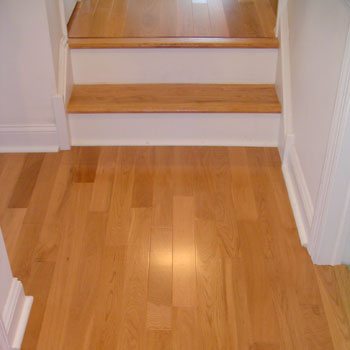 Sanded and refinished stair tread to match the Baywood, with contrasting white stair risers