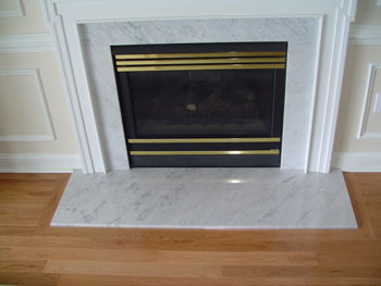 Picture frame border around marble hearth