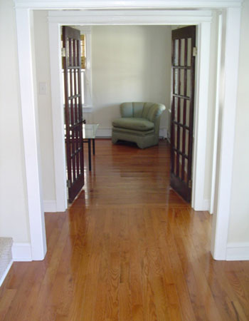 Living room and hall hardwood transition with contrasting installation angles