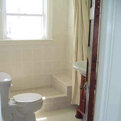 Full tile bathroom with tile floor and shower stall