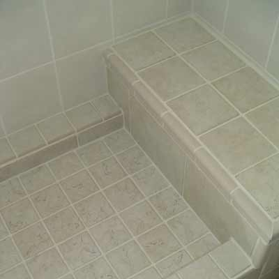 Tile shower basin with bench